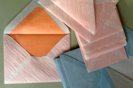 Luxurious, hand made fully lined onion skin envelopes. Shown are special order colors: white lined in orange and sky blue lined in white. Exclusively from Nancy Sharon Collins, Stationer.