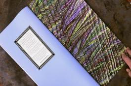 Nancy Sharon Collins, Stationer handmade ledger. Image shows engraved colophon and hand marbled endpapers.